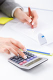 Hands working. On the calculator Royalty Free Stock Images
