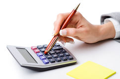 Hands working. On the calculator Stock Photography