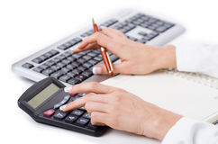 Hands working. On the calculator Stock Images