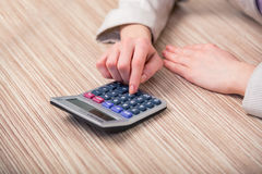 The hands working on the calculator Royalty Free Stock Photography