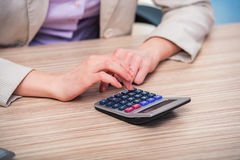 The hands working on the calculator. Hands working on the calculator Royalty Free Stock Photography