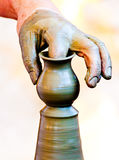 Hands working clay Stock Photo