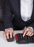 Hands working on computer keyboard and mouse. Business hands working on computer keyboard and mouse stock photo