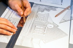 Hands working on construction layout project. Royalty Free Stock Photography