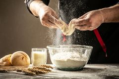 Hands working with dough preparation recipe bread, pizza or pie. Food concept. space for text.  royalty free stock image