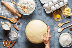 Hands working with dough preparation recipe bread, pizza or pie making ingridients Stock Photos