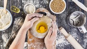 Hands working with dough preparation recipe bread, pizza or pie making ingridients, food flat lay on kitchen table background stock photography