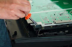 Hands working with electronic circuit board from Royalty Free Stock Photo