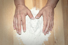 Hands working with flour Royalty Free Stock Images