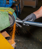 Hands working on a grinding machine Royalty Free Stock Image