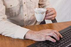 Hands working on a keyboard. Masculine hands working on a keyboard Stock Photography