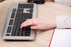 The hands working on the keyboard in the office Stock Photography