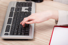 The hands working on the keyboard in the office Royalty Free Stock Photos
