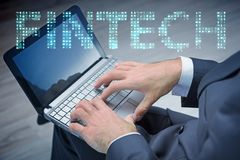 The hands working on laptop in financial technology fintech concept. Hands working on laptop in financial technology fintech concept Stock Photo