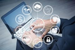 The hands working on laptop in financial technology fintech concept. Hands working on laptop in financial technology fintech concept Royalty Free Stock Photos