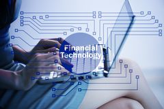 The hands working on laptop in financial technology fintech concept. Hands working on laptop in financial technology fintech concept Royalty Free Stock Photo