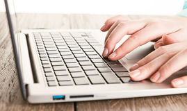 Hands working on laptop Stock Image