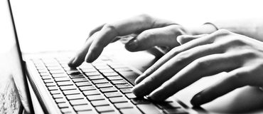 Hands working on laptop Stock Images