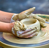Hands working on pottery Stock Image