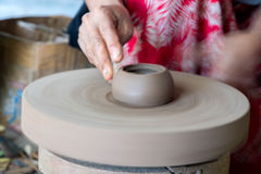 Hands while working pottery close up detail Royalty Free Stock Image