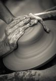 Hands working on pottery wheel ,  artistic  toned Royalty Free Stock Image