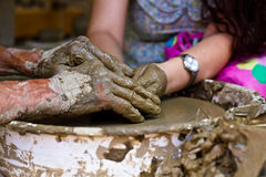 Hands working on pottery wheel , close up Royalty Free Stock Image