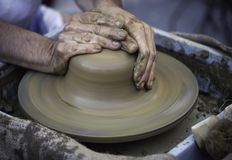 Hands working on pottery wheel Royalty Free Stock Photo
