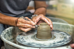 Hands working on pottery wheel Stock Photos