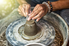 Hands working on pottery wheel Royalty Free Stock Images