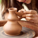 Hands working on pottery wheel Royalty Free Stock Image