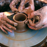 Hands working on pottery wheel Stock Image