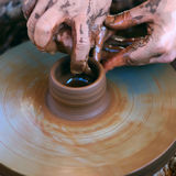 Hands working on pottery wheel Stock Photography