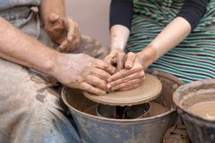 Pottery making. Hands working on pottery wheel. Hands working on pottery wheel. Pottery making Stock Photography