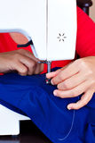 Hands working on a sewing machine Royalty Free Stock Photo