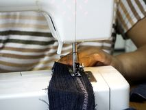 Hands working on the sewing machine royalty free stock photo