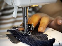 Hands working on the sewing machine royalty free stock images