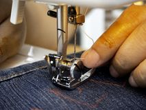Hands working on the sewing machine royalty free stock photos