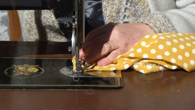 Hands working on sewing machine frontal closeup MF stock video footage
