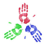 Hands working together. Red blue and green finger painted hand print Royalty Free Stock Photography