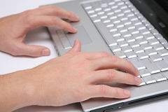 Hands working typing laptop keyboard Royalty Free Stock Image