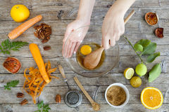 Hands working on wooden kitchen table with raw ingredients Royalty Free Stock Photo