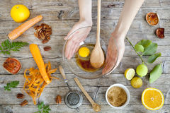Hands working on wooden table with raw ingredients and utensils Royalty Free Stock Photography