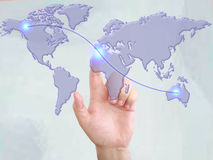 Hands with world mail delivery on world map Royalty Free Stock Image
