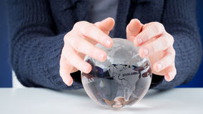 Hands and world - protection and care concept Stock Images