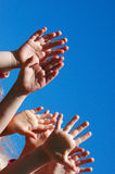 Hands of worshipping kids Royalty Free Stock Photo