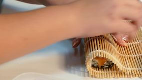 Hands wrap the sushi roll stock video