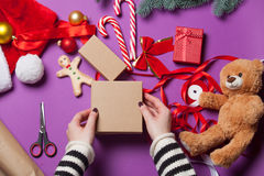 Hands are wrapping a christmas gift Royalty Free Stock Images
