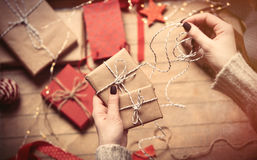 Hands wrapping gifts Stock Images