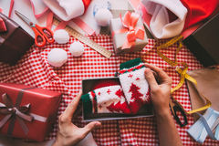 Hands wrapping modern Christmas gifts. Stock Image