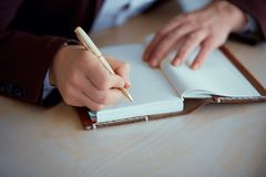 Hands write in a notebook royalty free stock photos